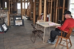 Jake Jaco sitting inside the old Olympia Schoolhouse