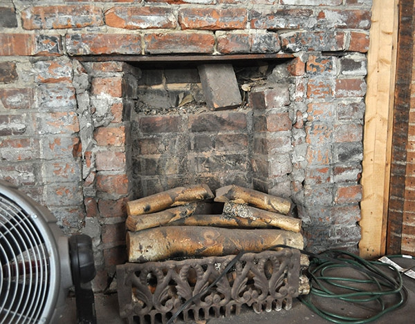 Original coal-fired fireplace in Olympia Schoolhouse