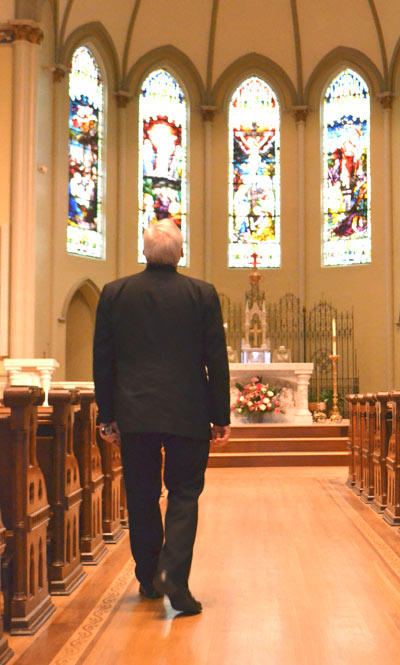 The Rev. Gary Linsky in St. Peter's sanctuary.