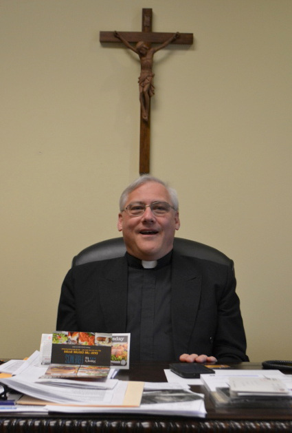 The Rev. Gary Linsky at his desk at St. Peter's.