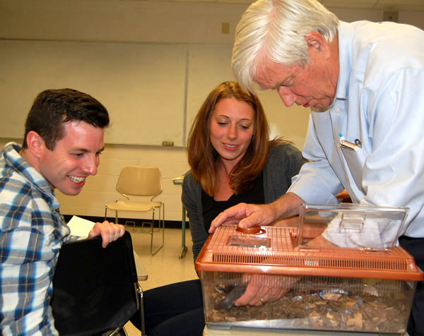 Rudy Mancke observes snake with students
