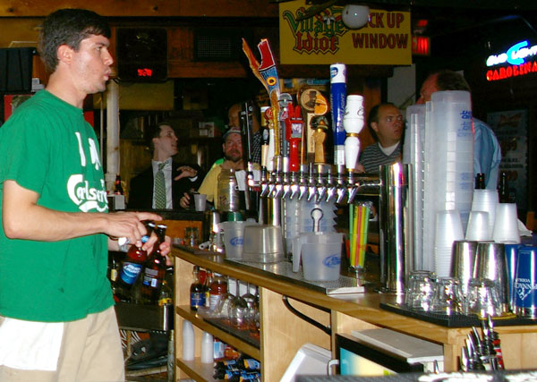 Bartenders at the Village Idiot in Five Points serve the nightly drink specials. Cheap drinks along with cheap pizza attract late-night students, but owners Brian and Kelly Glynn say they've also tried to develop a lunch and dinner business for a different crowd, which has helped the almost 25-year-old bar become one of the few in Five Points that have lasted.