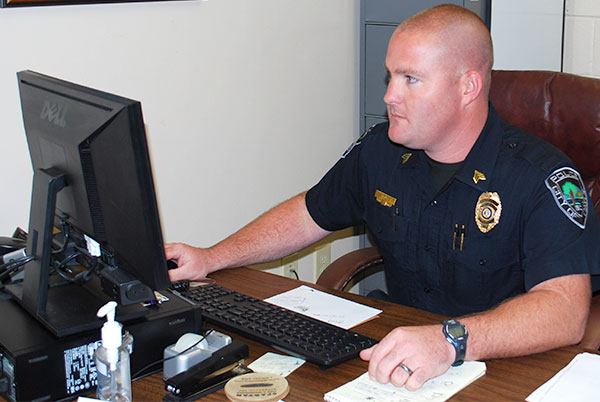 Sgt. Evan Antley at desk