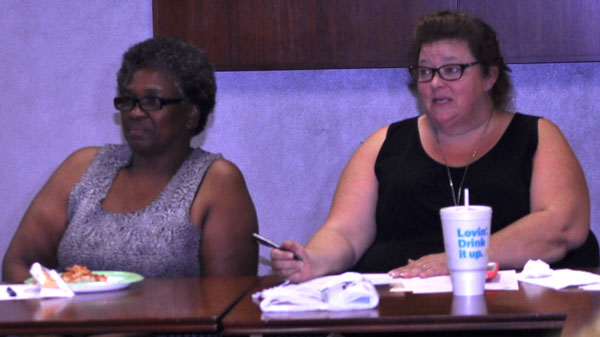 Michele Huggins at community meeting.