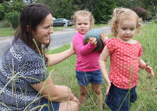 Olympia resident Brana Wallace uses Organic Hope to educate her two daughters, Lilla, 3, center, and Chloe, 4, about gardening.