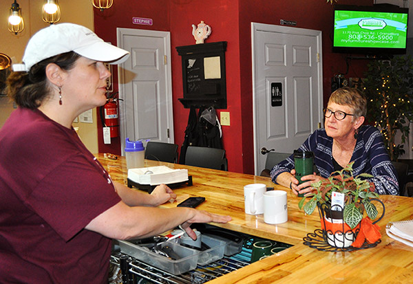Local Buzz owner Stephanie Bridgers and customer Debbie McDaniel
