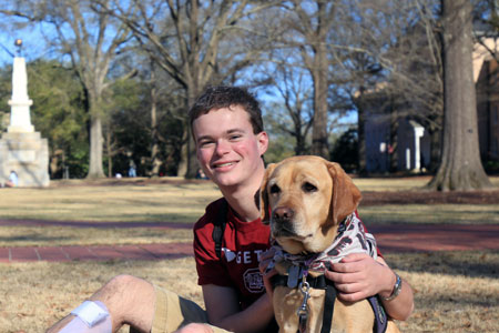 USC senior Jory Fleming with his service dog, Daisy. The two companions were acquainted in 2013.
