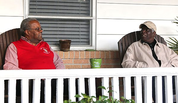 Houston and Baker sitting on porch.