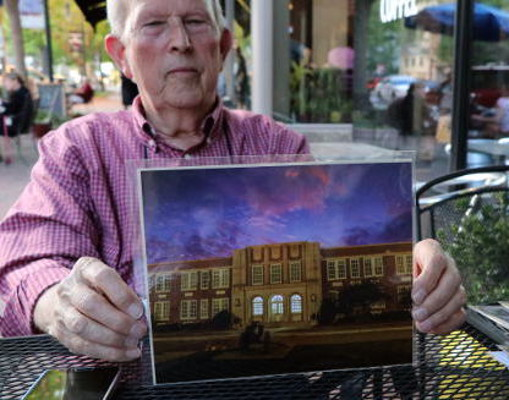 Photographer Charles Hite holds his photo of Brookland-Cayce High School.
