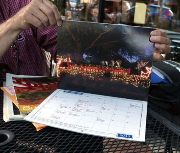 Charles Hite with his his photo in the Cayce 2012-2013 calendar.