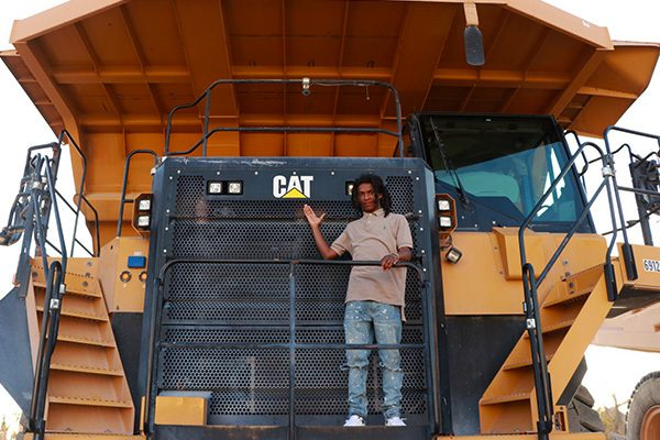 Dwayne Alston standing on Caterpillar 777 G