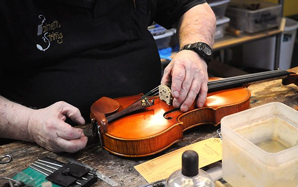 Gregg Lange works on violin