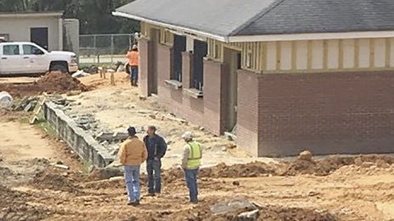 Construction workers at Memorial Stadium new concession stand