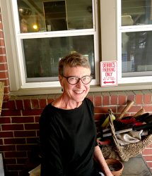 Debbie McDaniel sits on her porch