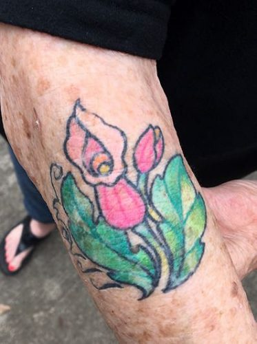 Debbie McDaniel shows her tattoo